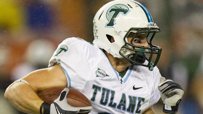 FILE - This Nov. 26, 2011 file photo shows Tulane wide receiver Wilson Van Hooser (9) taking off running in the third quarter of an NCAA college football game in Honolulu. A person familiar with the decision tells The Associated Press that Tulane University is joining the Big East as a full member in 2014 and East Carolina will be joining as a football-only member. The person spoke to the AP on condition of anonymity because neither the conference nor school was prepared to make an official announcement.(AP Photo/Eugene Tanner, File)