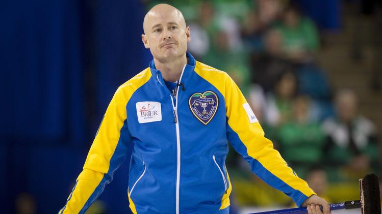 Team Alberta skip Kevin Koe reacts after missing a shot against team Quebec in the 7th end of their draw during the 2014 Tim Hortons Brier curling championships in Kamloops