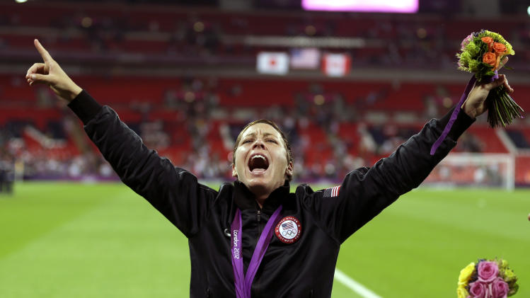 United States' Abby Wambach celebrates winning the gold medal in their women's soccer final against Japan at the 2012 Summer Olympics, Thursday, Aug. 9, 2012, in London. (AP Photo/Ben Curtis)