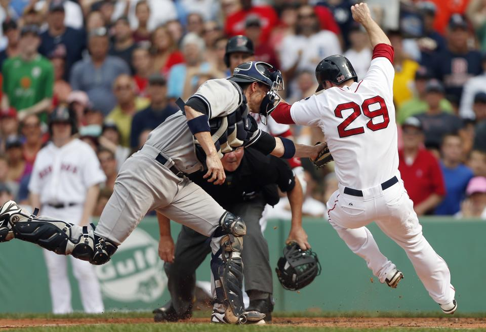 New York Yankees' Chris Stewart, left, tags out Boston Red Sox's Daniel Nava in the first inning of a baseball game in Boston, Saturday, July 20, 2013. (AP Photo/Michael Dwyer)