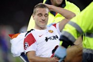 Manchester United&#39;s Nemanja Vidic is stretchered off after injury during their UEFA Champions League group C football match against Basel in December 2011 in Basel. Vidic will miss the next eight weeks after undergoing surgery on a knee injury, the Premier League club has announced
