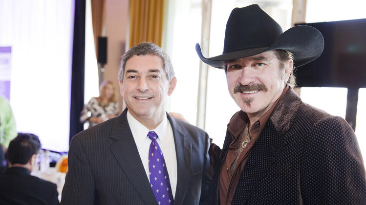 IMAGE DISTRIBUTED FOR LOUISIANATRAVEL.COM - From left, Lt. Governor Jay Dardenne shared emcee duties with country music artist and Louisiana native Kix Brooks at the Only In Louisiana brunch at the Dorothy Chandler Pavilion on Saturday, Feb. 9, 2013, in Los Angeles. (Photo by Colin Young-Wolff/Invision for  LouisianaTravel.com/AP Images)