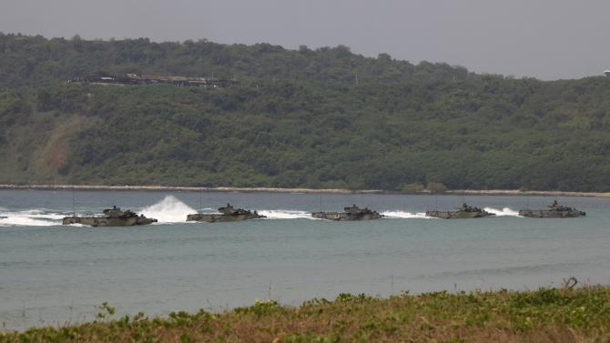 "Thai Marines in their amphibious assault vehicles (AAV) participate in an exercise as part of the ""Cobra Gold 2013"" (CG13) joint military exercise at a military base in Chonburi province"