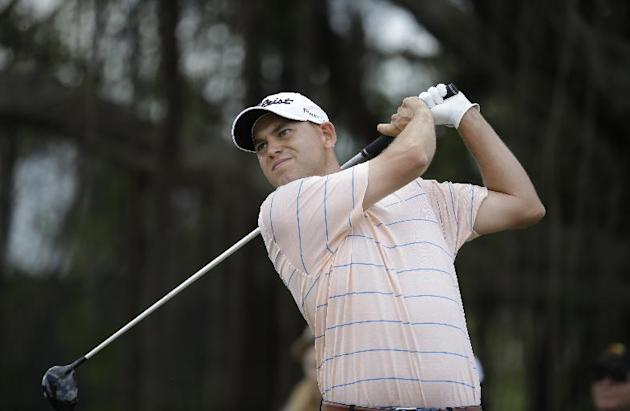 Bill Haas hits from the fifth tee during the final round of the Cadillac Championship golf tournament on Sunday, March 9, 2014, in Doral, Fla