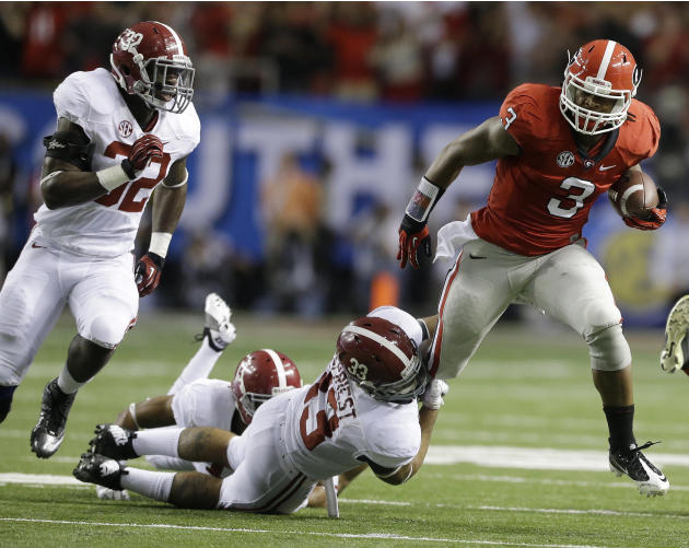 Georgia running back Todd Gurley (3) breaks the tackle of Alabama linebacker Trey DePriest (33) during the first half of the Southeastern Conference championship NCAA college football game, Saturday,