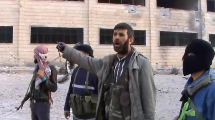 In this Sunday March 3, 2013 image taken from video obtained from the Shaam News Network, which has been authenticated based on its contents and other AP reporting, Syrian rebel fighters tour the police academy complex in Khan al-Asal, in the province of Aleppo, Syria. The Britain-based Syrian Observatory for Human Rights said the rebels seized the police academy in Khan al-Asal after entering the sprawling government complex with captured tanks. The Observatory said the battle left at least 120 soldiers and 80 rebels dead. (AP Photo/Shaam News Network via AP video)