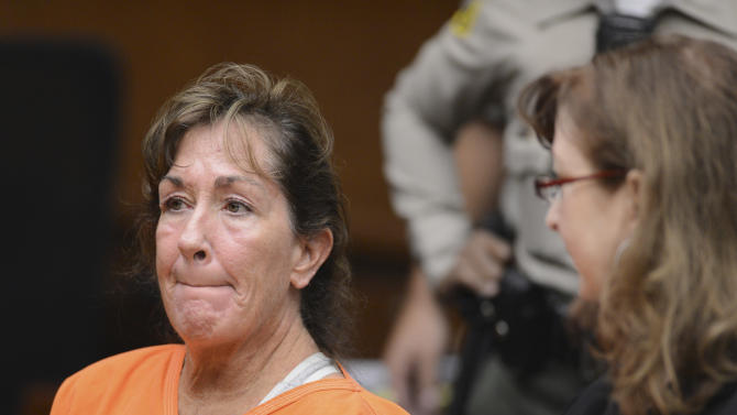 Sherri Wilkins, a substance abuse counselor, appears in Los Angeles Superior Court in Torrance, Calif., Tuesday, Nov. 27, 2012. Wilkins, 51, who was allegedly driving under the influence, has been accused of striking a pedestrian and then driving for more than two miles with the dying victim lodged in the windshield and on the hood of her car.  Los Angeles County prosecutors have filed murder and drunken-driving charges against Wilkins. The victim, Phillip Moreno, 31, died later at a hospital. At right is public defender Ethna Burns. (AP Photo/Brad Graverson, Daily Breeze, Pool)