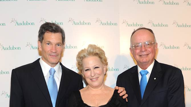 IMAGE DISTRIBUTED FOR THE NATIONAL AUDUBON SOCIETY - Bette Midler poses with honorees Louis Bacon, left, and George Archibald at The National Audubon Society's first gala to jointly award the Audubon Medal and the inaugural Dan W. Lufkin Prize for Environmental Leadership, Thursday, Jan. 17, 2013, in New York.  (Photo by Diane Bondareff/Invision for The National Audubon Society/AP Images)