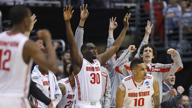 Ohio State players celebrate a 3-point shot against Arizona by LaQuinton Ross (10) during the second half of a West Regional semifinal in the NCAA men's college basketball tournament, Thursday, March 28, 2013, in Los Angeles. (AP Photo/Jae C. Hong)