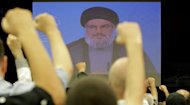 &lt;p&gt;Lebanese Shiite men raise their fists up as they listen to a speech via videolink by Hezbollah leader Hassan Nasrallah in the southern suburbs of Beirut on August 17. US authorities on Monday announced the seizure of $150 million allegedly linked to a Hezbollah scheme to launder proceeds from drug trafficking and other crimes.&lt;/p&gt;