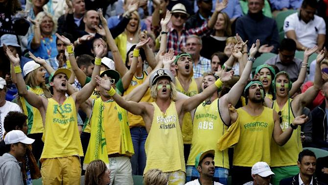 Supporters of Australia's Nick Kyrgios cheer ahead of his quarterfinal match against Andy Murray of Britain at the Australian Open tennis championship in Melbourne, Australia, Tuesday, Jan. 27, 2015. (AP Photo/Lee Jin-man)