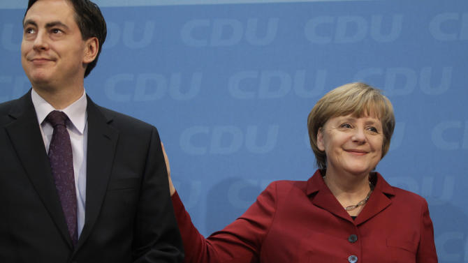 German Chancellor and chairwoman of the German Christian Democrats, CDU, Angela Merkel, right, and the CDU top candidate of the Lower Saxony state elections, David McAllister, left, leave the podium after a press conference after the party's weekly executive committee meeting in Berlin, Germany, Monday, Jan. 21, 2013.  German Chancellor Angela Merkel says a state election loss months before a national vote was painful — but she's downplaying the implications for her quest for a third term. (AP Photo/Michael Sohn)