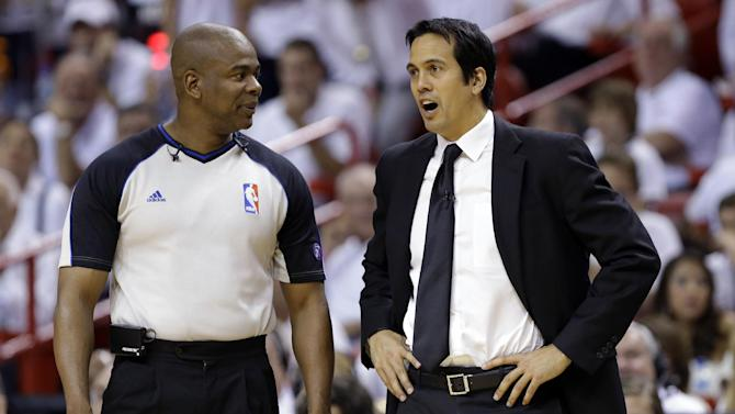 Referee Sean Wright, left, talks with Miami Heat head coach Erik Spoelstra during the first half of Game 2 of their NBA basketball playoff series in the Eastern Conference semifinals against the Chicago Bulls, Wednesday, May 8, 2013, in Miami. (AP Photo/Lynne Sladky)