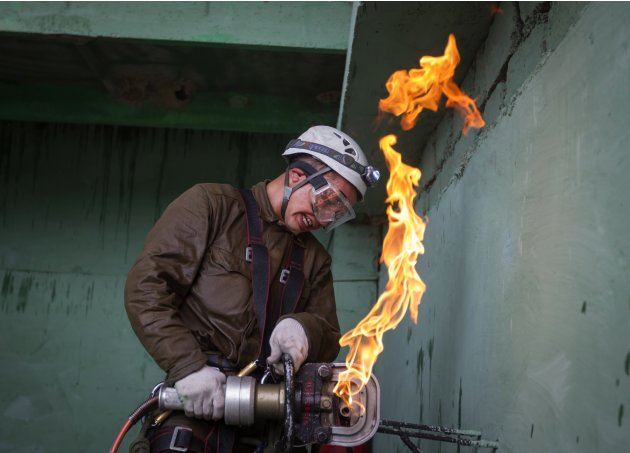 A rescuer cuts a gas pipeline during an international workshop called Kazspas 2013 on a range