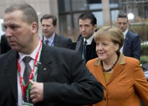 German Chancellor Angela Merkel, right, arrives for …