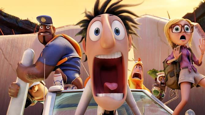 """This film image released by Sony Pictures Animation shows characters, from left, Earl, voiced by Terry Crews, Flint, voiced by Bill Hader, and Sam, voiced by Anna Faris in a scene from """"Cloudy with a Chance of Meatballs."""" (AP Photo/Sony Pictures Animation)"""