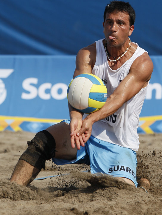 Argentina's Pablo Suarez, in action, during the men's beach volleyball bronze medal match against Mexico at the Pan American Games in Puerto Vallarta, Mexico, Saturday Oct. 22, 2011. (AP Photo/Ariana