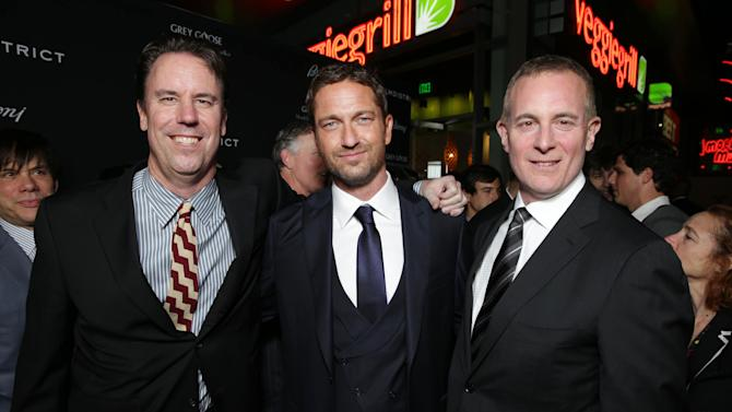 Millennium Films' Mark Gill, Gerard Butler and Executive Producer/FilmDistrict's Peter Schlessel at FilmDistrict's Premiere of 'Olympus Has Fallen' hosted by Brioni and Grey Goose at the ArcLight Hollywood, on Monday, March, 18, 2013 in Los Angeles. (Photo by Eric Charbonneau/Invision for FilmDistrict/AP Images)