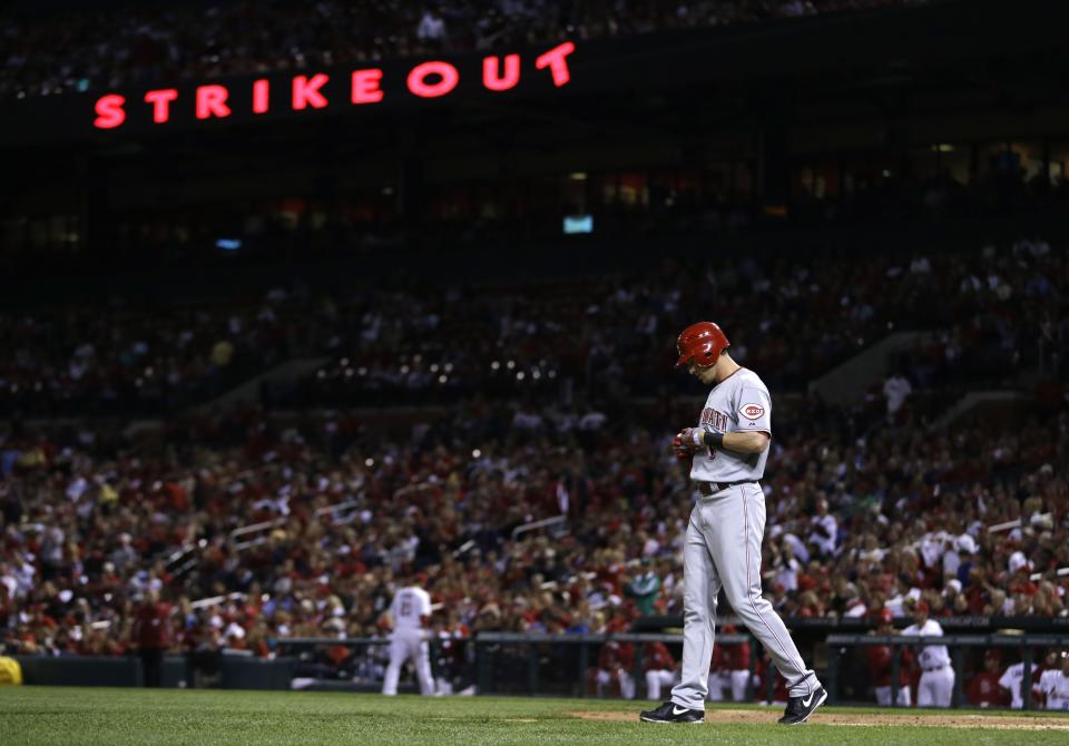 Cincinnati Reds' Drew Stubbs walks way from the batter's box after striking out to end the top of the second inning of a baseball game against the St. Louis Cardinals, Tuesday, Oct. 2, 2012, in St. Louis. (AP Photo/Jeff Roberson)