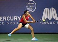 Marion Bartoli of France returns to Vania King during day five of the Mercury Insurance Open Presented By Tri-City Medical at La Costa Resort & Spa, on July 18, in Carlsbad, California. The top-seeded Bartoli struggled in her second round win (6-4, 5-7, 6-4) as she needed treatment on her left hip