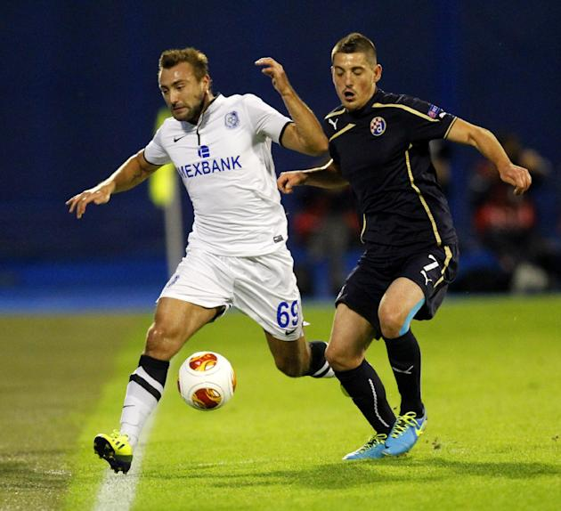 Chornomorets' Odessa\s Olexiy Antonov, left, is challenged by Dinamo Zagreb's Arijan Ademi during their Europa League  group B soccer  match,   in Zagreb, Croatia, Thursday, Sept. 19, 2013
