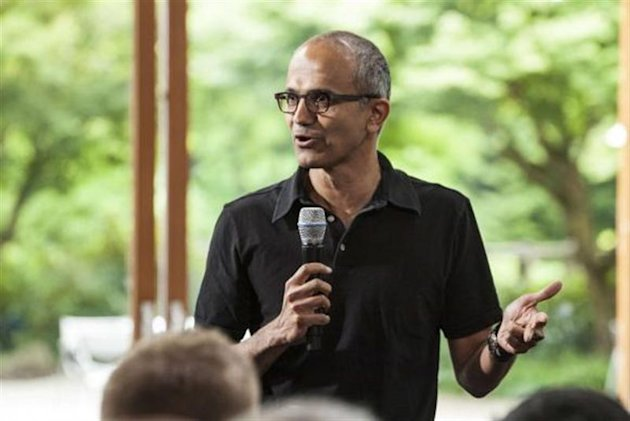 Satya Nadella, executive vice president, Cloud and Enterprise, addresses employees during the One Microsoft Town Hall event in Seattle, Washington in this July 11, 2013 photo made available to Reuters on January 30, 2014. REUTERS/Microsoft/Handout