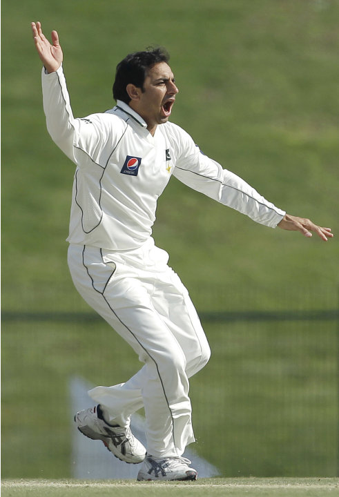 Pakistan's Saeed Ajmal celebrates after taking the wicket of England's Matt Prior, not pictured, lbw during the third day of their second cricket test match of a three-match series at Zayed Cricket St