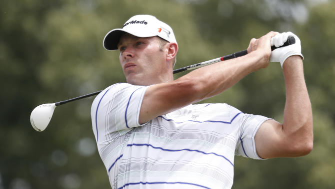Shawn Stefani watches his tee shot on the ninth hole during the third round of the St. Jude Classic golf tournament Saturday, June 8, 2013, in Memphis, Tenn. (AP Photo/Rogelio V. Solis)
