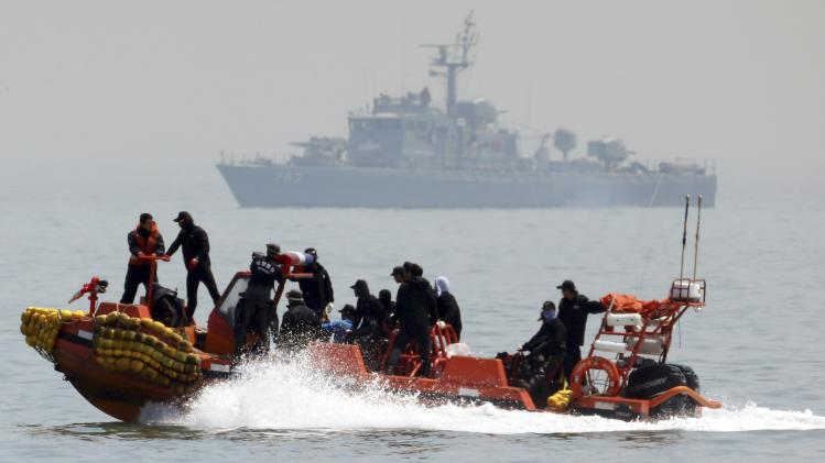 South Korean rescue workers operate around the area where capsized passenger ship Sewol sank during an rescue operation in Jindo