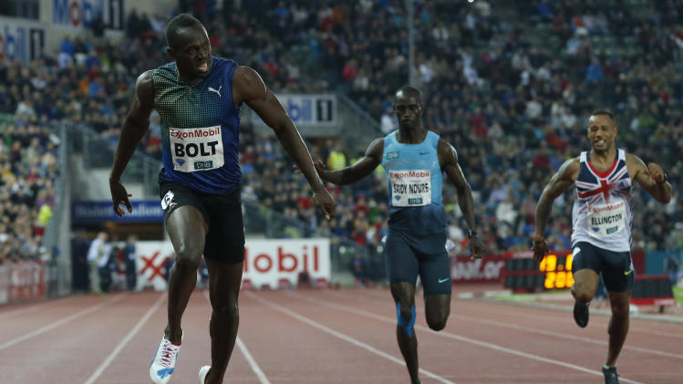 Usain Bolt of Jamaica, left, competes in and wins the men's 200 metres during the Diamond League athletics competition at the Bislett Stadium in Oslo, Thursday June 13, 2013. (AP Photo/NTB Scanpix, Cornelius Poppe) NORWAY OUT