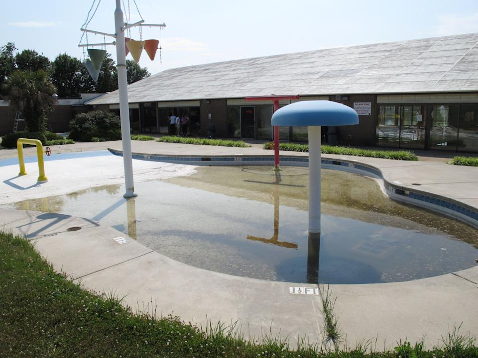 In this May 11, 2011 photo, the splash zone at Sheppard Swim Center is shown in Anderson, S.C. The splash zone won't be used after city officials closed it and the indoor pool to the public because of budget cuts. (AP Photo/Jeffrey Collins)