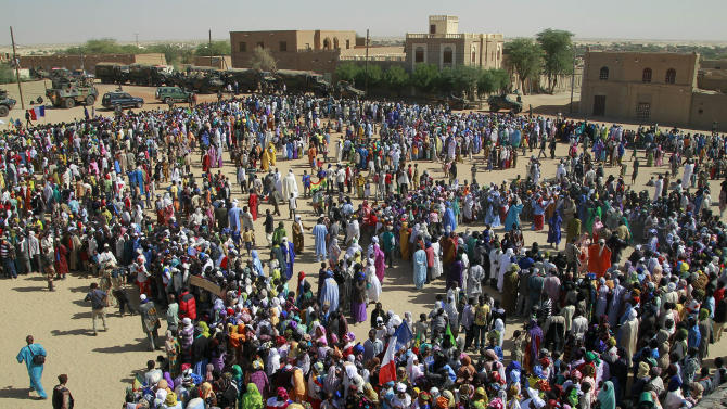 Well-wishers gather to greet French President Francois Hollande during his two-hour-long visit to Timbuktu, Mali, Saturday Feb. 2, 2013.(AP Photo/Jerome Delay)