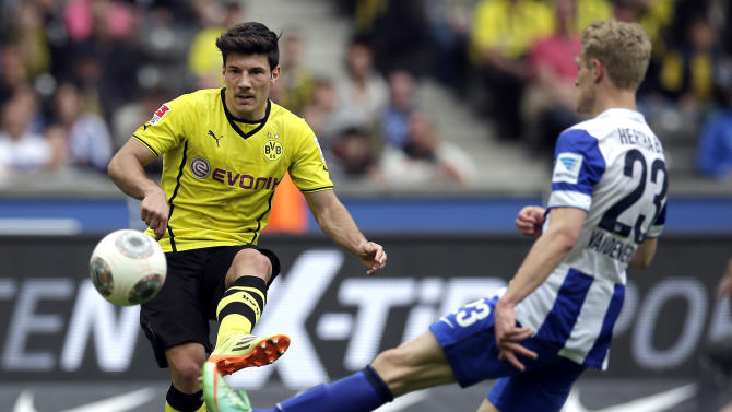 Dortmund's Milos Jojic of Serbia, left, scores his side's second goal during the German Bundesliga soccer match between Hertha BSC Berlin and Borussia Dortmund in in Berlin, Germany, Saturday, May 10, 2014. (AP Photo/Michael Sohn)
