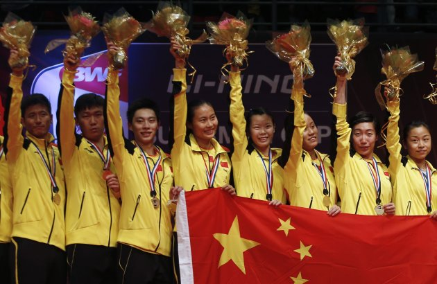 China's players celebrate during the awards presentation ceremony at the Sudirman Cup World Team Badminton Championships in Kuala Lumpur