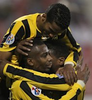 Saudi Arabia's Al-Ittihad players celebrate after scoring during an AFC Champions League match on March 20. On Wednesday, Al Ittihad entertain Iran's Piroozi Athletic in Jeddah in a simultaneous Saudi Arabian double-header