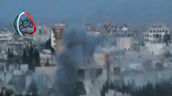 In this image taken from video obtained from the Shaam News Network, which has been authenticated based on its contents and other AP reporting, smoke rises from shelling in a suburb of Damascus, Syria, Tuesday, March 26, 2013. Mortar rounds struck several areas of Damascus on Tuesday, killing several people, a government official said, while anti-regime activists said Syrian troops seized control of a neighborhood in the central city of Homs that is considered a symbol of opposition to President Bashar Assad's regime. (AP Photo/Shaam News Network via AP video)