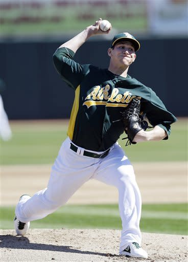 A's RHP Parker sharp in spring debut, Giants win
