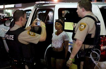 File photo of police taking a mugshot of a protester who was detained in Ferguson, Missouri