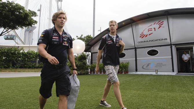 Red Bull Formula One driver Sebastian Vettel of Germany arrives at the paddock ahead of the third practice session of the Singapore F1 Grand Prix in Singapore