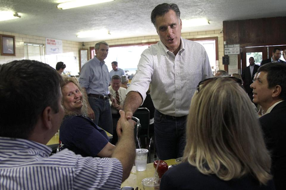 Republican presidential candidate, former Massachusetts Gov. Mitt Romney greets supporters during a campaign stop at Tom's ice cream,  Tuesday, Aug. 14, 2012 in Zanesville, Ohio. Sen. Rob Portman, R-Ohio is at left.  (AP Photo/Mary Altaffer)