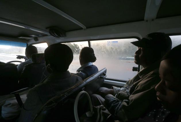 Passengers travel in Zakes Hadebe's minibus taxi from Soweto township to central Johannesburg