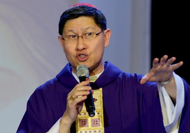 Filipino cardinal Luis Antonio Tagle gives a mass to the faithful in Manila on February 16, 2013. Tagle is carrying the hopes of Asia and those of his country's 80 million Catholics in the race to succeed Pope Benedict XVI
