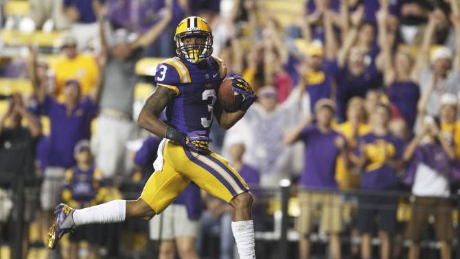 LSU wide receiver Odell Beckham (3) looks for Towson defenders as he heads to the end zone with a 53-yard reception for a touchdown in the second half of an NCAA college football game in Baton Rouge, La., Saturday, Sept. 29, 2012. (AP Photo/Bill Haber)