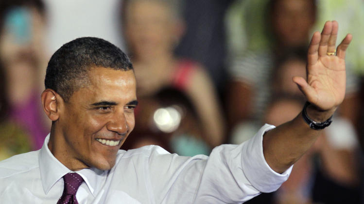 President Obama waves to supporters during a grassroots campaign speech Friday, June 22, 2012, at Hillsborough Community College in Tampa, Fla. (AP Photo/Chris O'Meara)