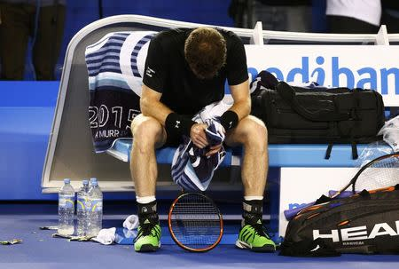 Murray of Britain reacts in his chair after losing a game to Djokovic of Serbia during their men's singles final match at the Australian Open 2015 tennis tournament in Melbourne