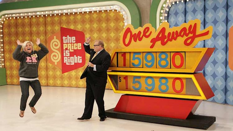 "Host Drew Carey plays ""One Away"" with contestant Amor Raciano on The Price is Right."
