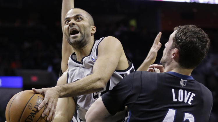 San Antonio Spurs' Tony Parker, left, of France, shoots over Minnesota Timberwolves' Kevin Love (42) during the first half of an NBA basketball game, Sunday, Jan. 12, 2014, in San Antonio. (AP Photo/Eric Gay)