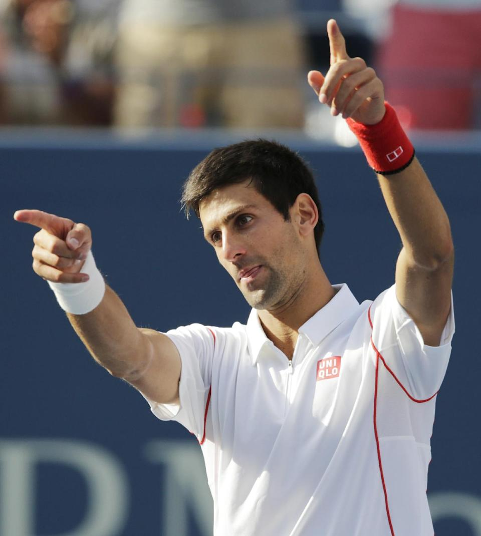 Novak Djokovic, of Serbia, reacts to the crowd after defeating Stanislas Wawrinka, of Switzerland, during the semifinals of the 2013 U.S. Open tennis tournament, Saturday, Sept. 7, 2013, in New York. (AP Photo/Charles Krupa)