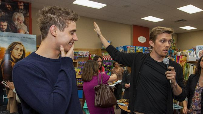 """Actor Max Irons and actor Jake Abel during """"The Host"""" book signing at the Anderson's Bookshop on Monday, March 11, 2013, in Chicago. (Photo by Barry Brecheisen/Invision/AP)"""