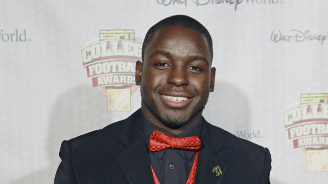 CORRECTS SPELLING TO MONTEE, NOT MONTE - Wisconsin's Montee Ball displays his Doak Walker Award after being named the nation's outstanding running back at the Home Depot College Football Awards in Lake Buena Vista, Fla., Thursday, Dec. 6, 2012. (AP Photo/John Raoux)